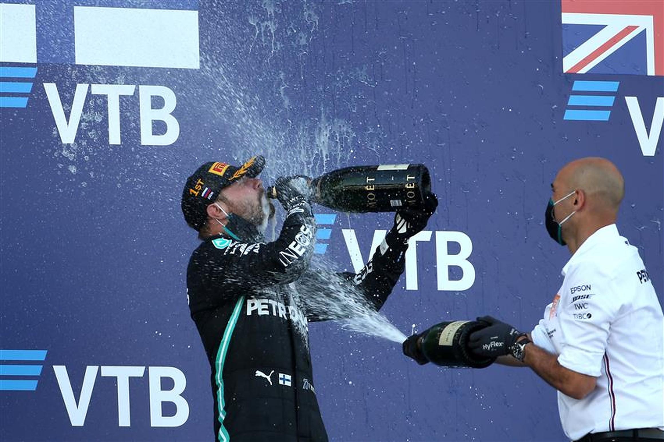 Dominique Riefstahl and Valtteri Bottas after winning 2020 Russian GP - Formula1News.co.uk